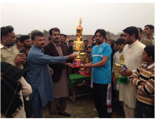 Sajjad Hotel Wala Recieving Trophy at Sufi Noor Hussain Tahiri's Hockey Tournament
